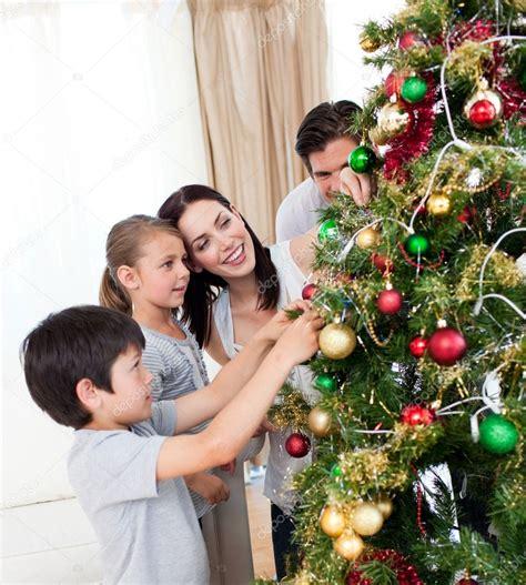 family christmas tree jarrettsville happy family decorating a tree with boubles stock photo 169 wavebreakmedia 10295511
