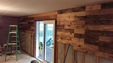 replacing wood paneling created a plank wall to replace paneling in lower level