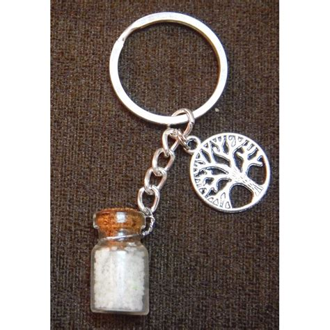 handmade key chain made of metal charm and glow in sand