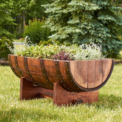Wooden Half Barrel Planters by Wooden Barrel Planter Interesting Design And Ornaments