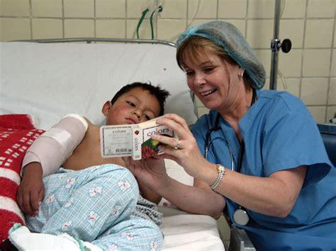 pacu tina cerruti reading to a post op patient flickr photo