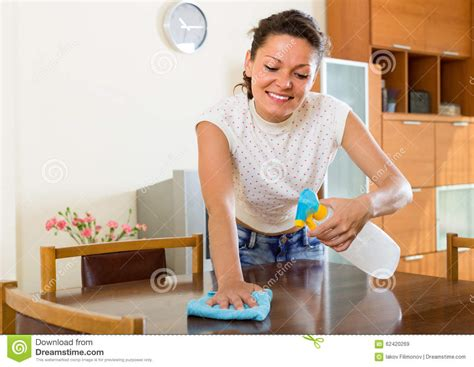 cleaning furniture with sprayer stock photo