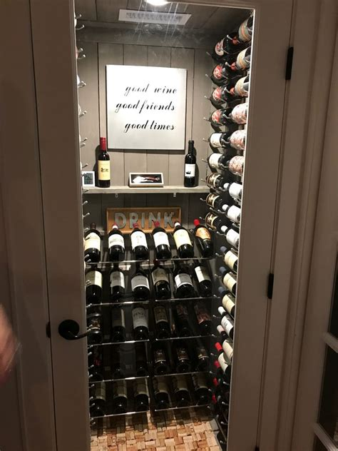 wine closet turning a water heater closet into a custom wine cellar in