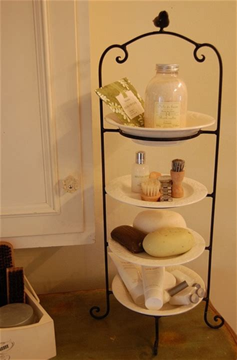 using the bathroom in space clever idea use a plate stand to create extra space on