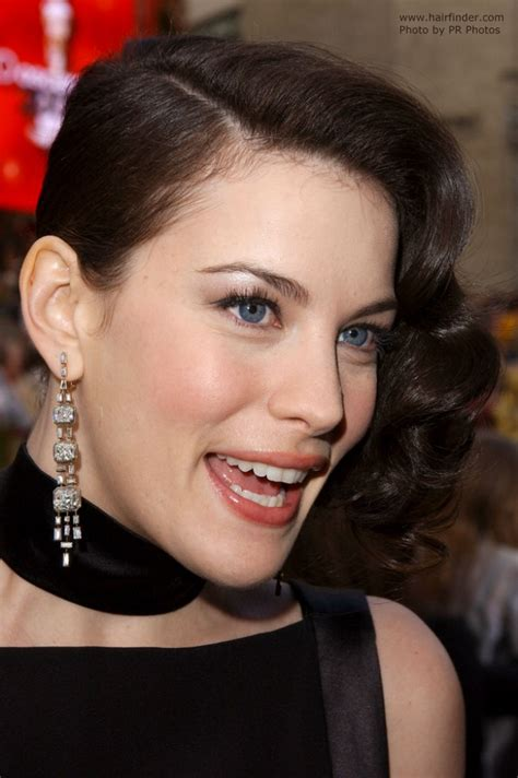 long hair style showing ears liv tyler wearing her hair in a shoulder long bob and