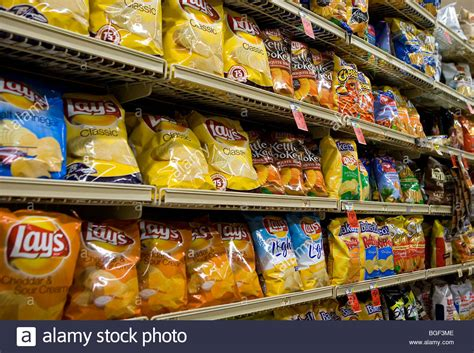 Shelf Of Potato Chips by Potato Chips On Display In A Grocery Store Stock Photo