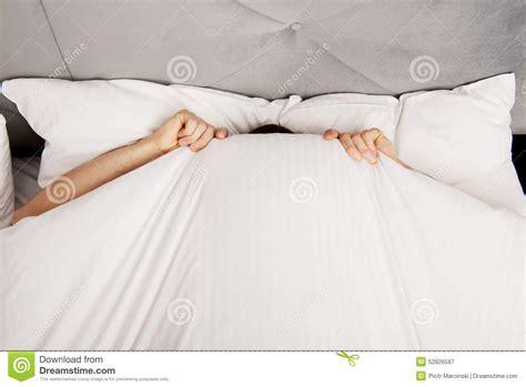 bed fan under sheets hiding under the sheets stock image cartoondealer com