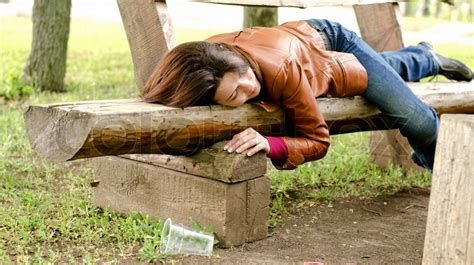 rape bench drunk woman sleeping it off on a wooden bench in a park
