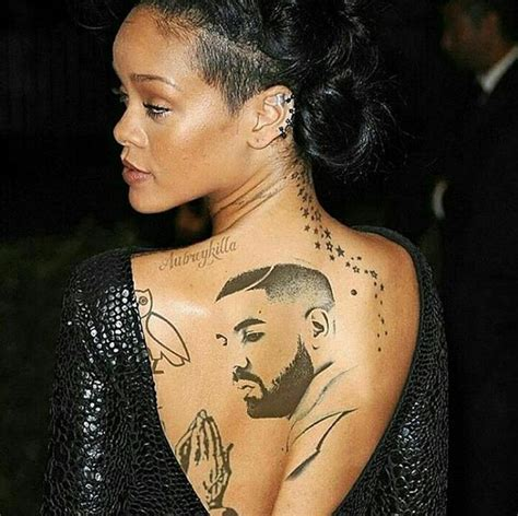 drakes tattoo turns out rihanna tattooed s on back see