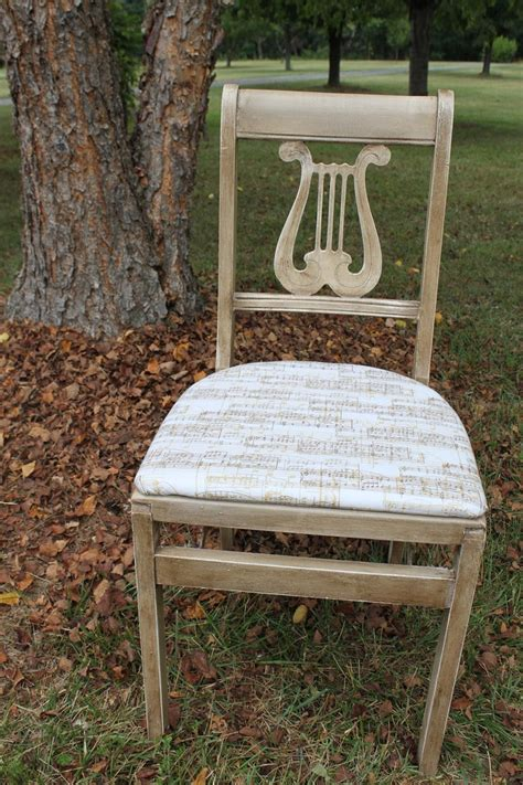 beautiful folding chairs beautiful lyre or harp back musical influence folding