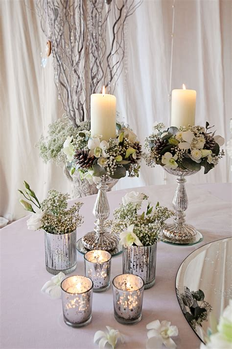 Table Vases For Weddings by Tiara Flower Arrangements Candle Stand Arrangements And Silver Votives Image By Alex Davies
