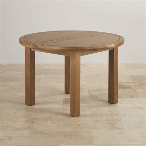 Round Extending Dining Table In Rustic Oak Oak Furniture Oak Furniture Land Dining Table