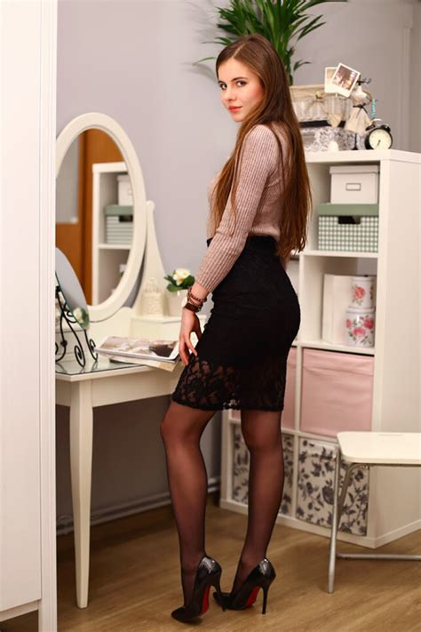 gallery stocking turtleneck sweater black lace skirt and black pantyhose