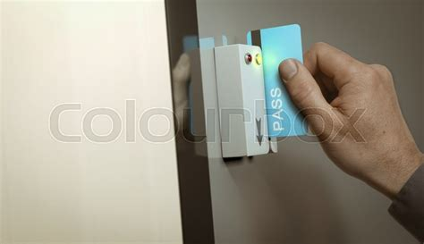 access 2 card with blue pass card unlocking access to a restricted area concept image for security and