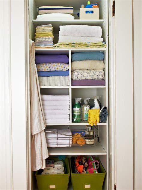 organizing  linen closet hgtv