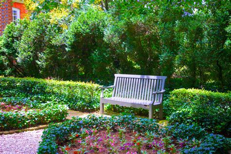 flower garden photos free park bench in flower garden free stock photo