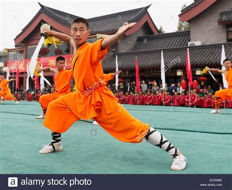Teh Orang Kung shaolin kung fu student with a broad sword performing at the opening stock photo royalty free
