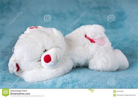 bear bed white teddy bear sleeping on the bed stock photo image