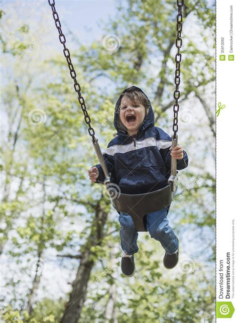 swinging people toddler boy swinging in the early spring stock photography
