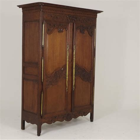antique wardrobes and armoires antique french normandy marriage armoire wardrobe 1840 at 1stdibs