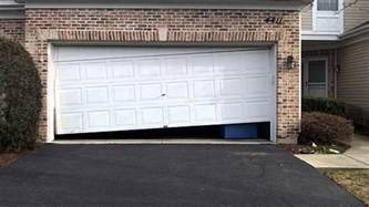 Open Garage Door With Broken by Garage Door Repair Service