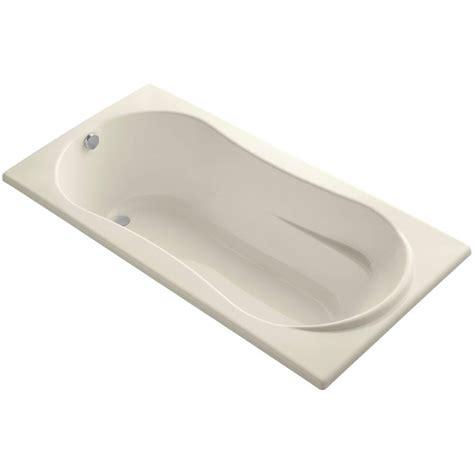 What Is A Reversible Drain Bathtub by Kohler 7236 6 Ft Reversible Drain Soaking Tub In Almond K