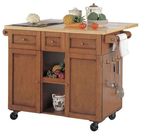 oak kitchen island cart powell medium oak 3 drawer kitchen butler with granite cutting board traditional kitchen