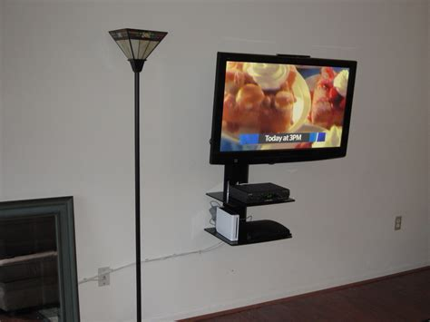 Wall Mounted Tv With Shelf Underneath by Interior Enchanting Tv Wall Mount With Shelf Ideas