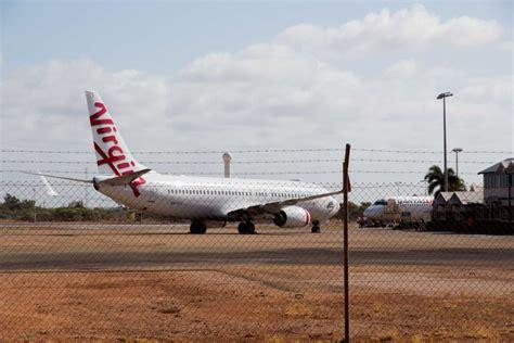 pesawat air asia perth bali mendarat darurut darurat medis penumpang penerbangan bali sydney dialihkan