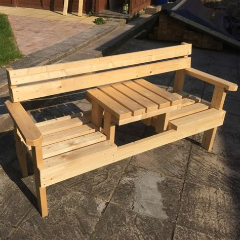 2 seater garden bench with small table in middle mowers