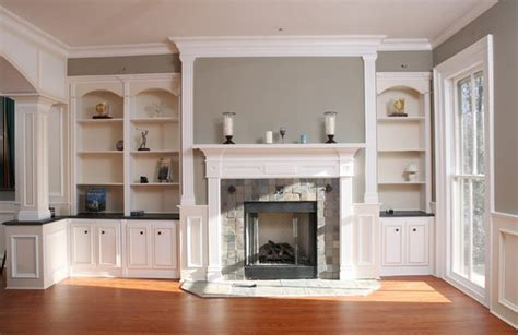 fireplaces with bookshelves on each side fireplace