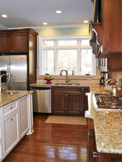 this kitchen s granite countertops give the traditional space added dimension the white