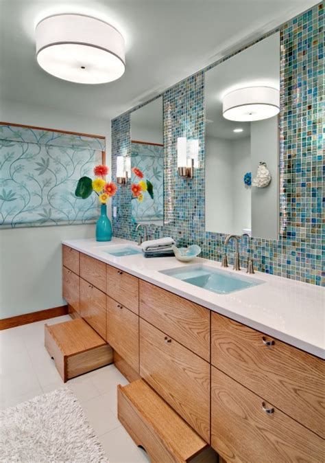Step Stools For Toddlers Bathroom by This Bathroom Features A Blue Sea Like Backsplash And Step Stools For Easy Kid