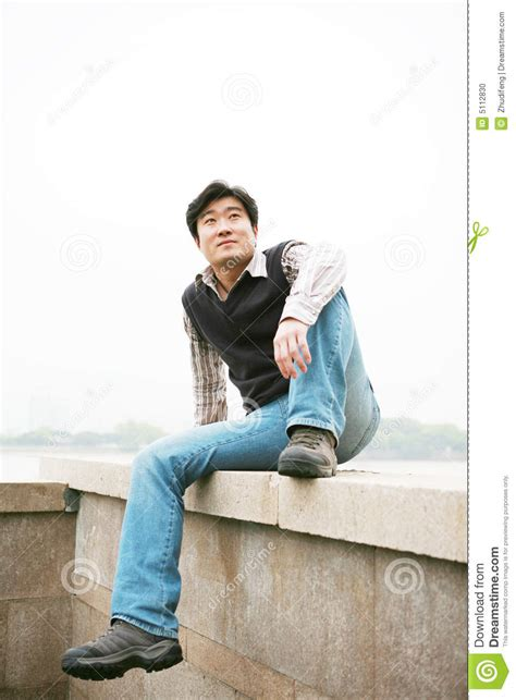 Sitting On by Sitting On Wall Stock Photo Image Of Outside