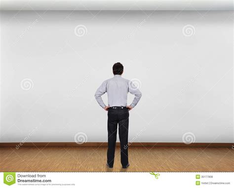 What Are Searching For On The Businessman Looking At Wall Stock Photo Image 35177808