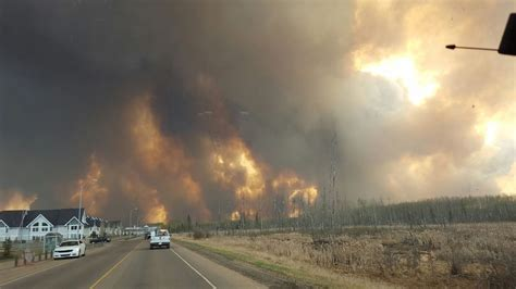 Wildfire At wildfires cause chaos in canada sands town