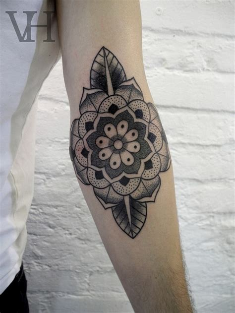 grey ink mandala flower elbow tattoo