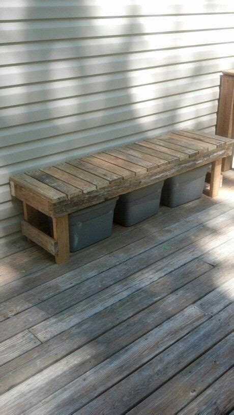 A bench made from pallets to hide the recycling bins