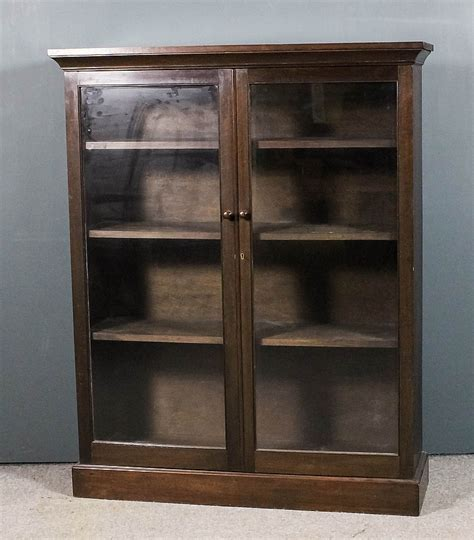 a stained hardwood bookcase with angled cornice f