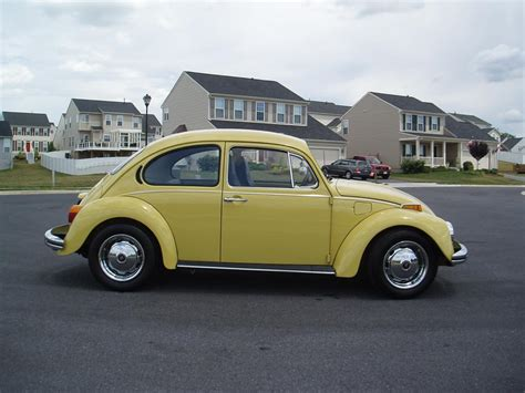 volkswagen yellow beetle 1973 yellow vw bug just like my first car cars i ve