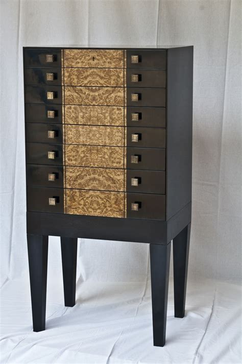 made sleek modern black and burl jewelry armoire by