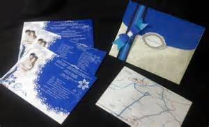 wedding invitations in royal blue motif stain