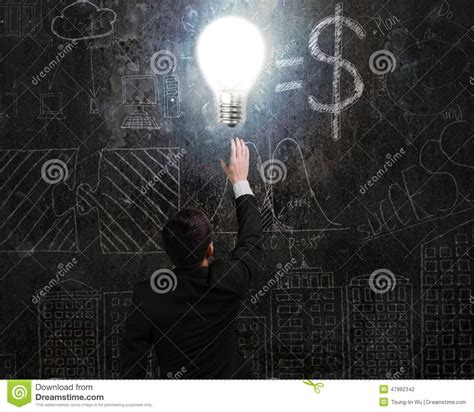 doodle god how to make light and darkness businessman touching brightly light bulb illuminated