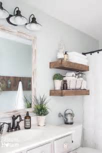 modern farmhouse bathroom with rustic wood shelving above toilet make hanging shelf for only