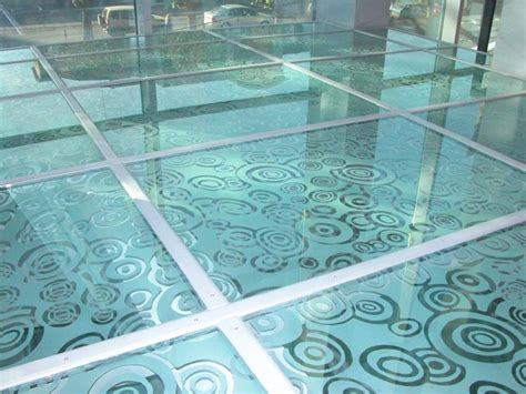 patterned glass floor acid etched passed through rollers