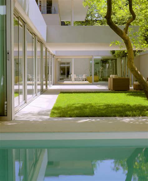 paradise in germany a modern minimalist dream house atrium house in munich harlaching max brunner architekt
