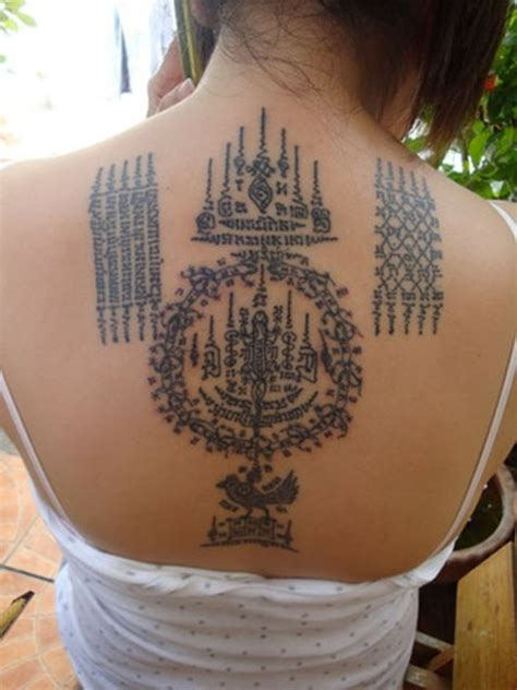 muay thai lines tattoo on upper back for girls