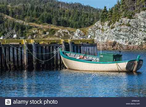 a small fishing boat tied up at the wharf in rural - Small Fishing Boats Canada