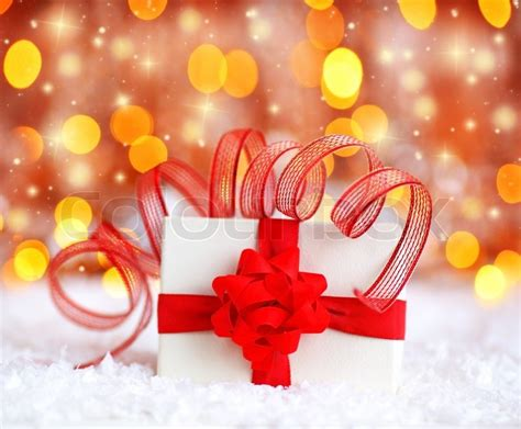 ribbon net christmas lights warm holiday background with white present gift box