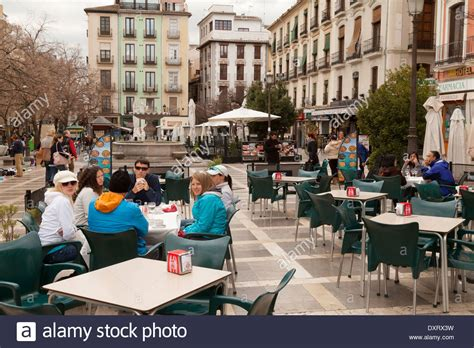 outdoor sitting sitting at an outdoor cafe plaza nueva granada